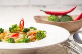 Italian penne pasta with broccoli and chili pepper — Stock Photo