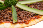 Turkish beef pizza with cucumber on top — Stock Photo