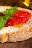 Italian fresh tomato and basil bruschetta — Stock Photo