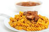 Fusilli pasta with neapolitan style ragu meat sauce — Stock Photo