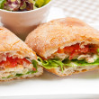 Photo: Ciabattpanini sandwich with chicken and tomato