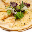 Garlic pita bread pizza with salad on top — Stock Photo