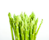 Fresh asparagus over white — Stockfoto