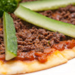 Stock Photo: Turkish beef pizza with cucumber on top