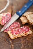 Italian salame pressato pressed slicing — Stock Photo