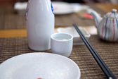 Japanese style table set and sake — Stock Photo