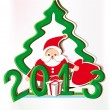 Paper date 2013 with a paper Santa Claus, Christmas tree — Imagen vectorial
