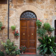 Wooden residential doorway in Tuscany. Italy — Photo #12453992