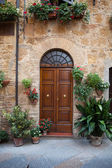 Wooden residential doorway in Tuscany. Italy — Stock Photo