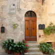 Wooden residential doorway in Tuscany - Stock Photo