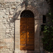 Stockfoto: Wooden residential doorway in Tuscany. Italy