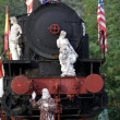 Marble sculptures on the old locomotive — Stock Photo