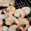 Grilled prawns on the barbecue - Stock Photo