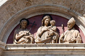 Madonna and Child on one of the portals in Montepulciano — Stock Photo