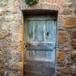 Wooden  door in Tuscany. Italy - Stock Photo
