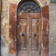 Wooden residential doorway in Tuscany. Italy - Stock Photo