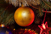 Christmas bauble on christmas tree — Stockfoto