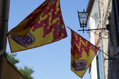 Festive flags on streets Asciano. Tuscany — Stock Photo