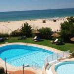 Постер, плакат: A section of the idyllic Praia de Rocha beach on the Algarve region