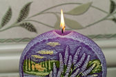 Candle with lavender flowers. Aromatherapy concept — Stock Photo