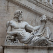 Rome - Sculpture of Tiber river in the Capitolium planed by Michelangelo. — Stock Photo #21490815