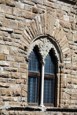 Florence - the stone wall Palazzo Vecchio with the beautiful window — Stok fotoğraf