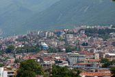 Mešita a mnoho domů v bursa, turecko — Stock fotografie