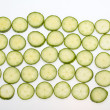 Stock Photo: Freshly sliced cucumber isolated on white background