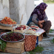 The woman dealing with fresh fruit on the street stall — Stock Photo