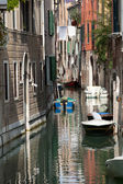 View of ancient buildings and narrow canal in Venice — Stock Photo