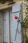 The romantic window with red roses — Stock Photo