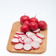 Garden radish on wooden board — Stock Photo #29840495