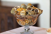 The ornamental vase with citrus-dried fruit — Stock Photo
