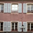 Facade with white window shutters — Stockfoto #34208975
