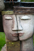 The flower pot in the form of the feminine head — Stock Photo