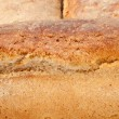 Loaves of bread traditionally roasted.  Background. Close up. — Stock Photo