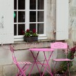 Empty pink table in the cafe during the rain — Stock Photo