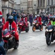 The parade of Santa Clauses on motorcycles around the Main Market Square in Cracow — Stockfoto