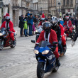 Parade of SantClauses on motorcycles around Main Market Square in Cracow — Stock Photo #36955355