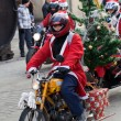 The parade of Santa Clauses on motorcycles around the Main Market Square in Cracow — Photo