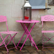 Empty pink table in the cafe during the rain — Stock Photo #37046139