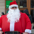 Stock Photo: Very fat SantClaus on street of city