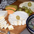 Cheese with white grapes . Close up — Stock Photo #39061429