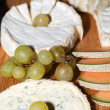 Cheese with white grapes . Close up — Stock Photo #39061553