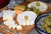 Cheese with white grapes . Close up — Stockfoto