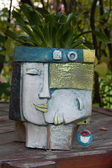 The flower pot in the form of the feminine head — Photo