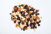 Mixed nuts and dried fruits isolated on white background — Foto de Stock