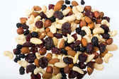 Mixed nuts and dried fruits isolated on white background — Stockfoto