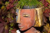 The flower pot in the form of the feminine head — Stok fotoğraf