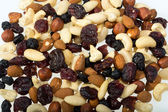 Mixed nuts and dried fruits isolated on white background — 图库照片